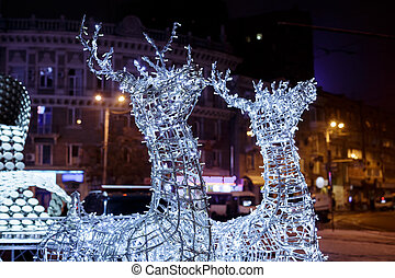 Glowing reindeer made of wire and light bulbs