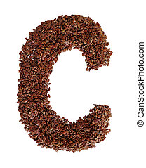 Letter C made with Linseed also known as flaxseed isolated...