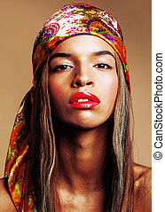 beauty young afro american woman in shawl on head smiling...