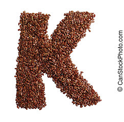 Letter K made with Linseed also known as flaxseed isolated...