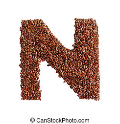 Letter N made with Linseed also known as flaxseed isolated...