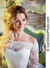 Portrait of charming woman in wedding dress. The girl bride...