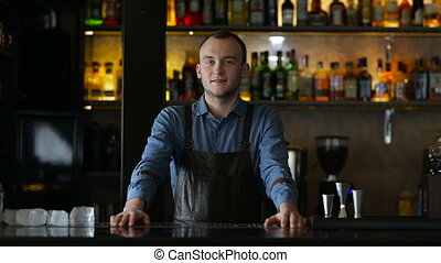 Portrait of a bartender at the bar