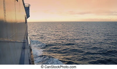 Pan From Horizon To Sea On Ship - Pan down from colorful sky...
