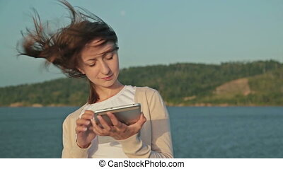 Woman using pc digital tablet on deck of cruise ship - Young...