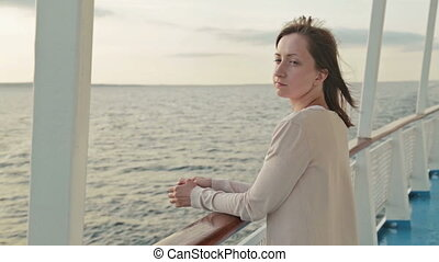 Young woman on cruise ship at sunrise - Young beautiful...