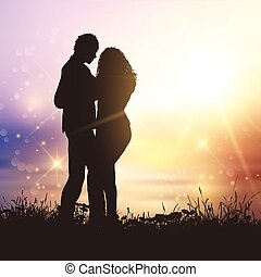 valentines couple in grassy sunset landscape - Silhouette of...