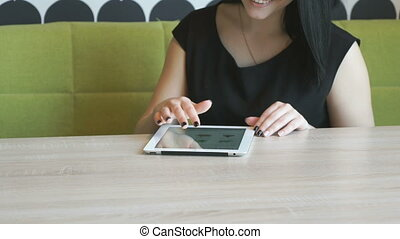 Girl watching photos with computer tablet indoors -...