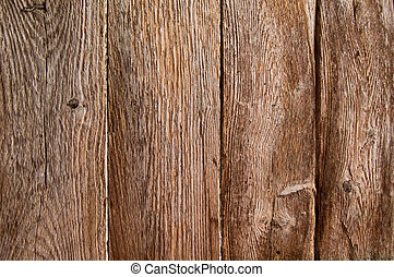 Weathered boards in an old barn door - Four vertical very...