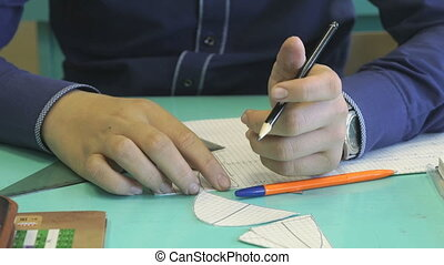 Student decides the task in a notebook in math - The student...