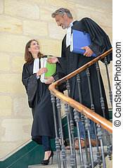 Magistrates decending staircase