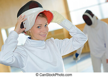 putting the fencing mask