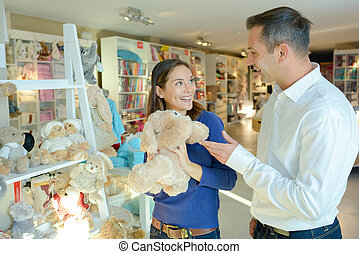 Couple choosing cuddly toy