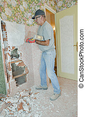 Hammering at a wall that needs to come down