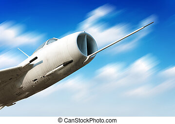 High-speed flight fighter, blue tone image. - Flying in the...