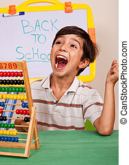 Boy with abacus screaming loudly in classroom environment