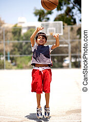 Basket ball jump, throw in - Young basketball player jumping...
