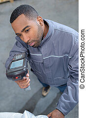 Man holding scanning device
