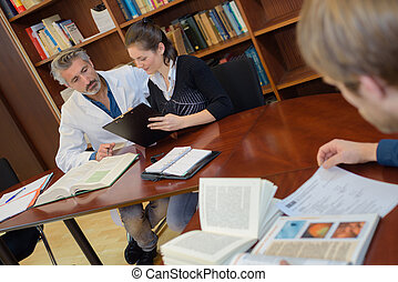 People in medical library