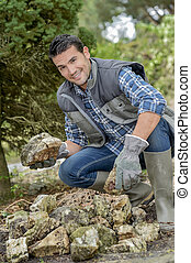 Gardener making rock formation