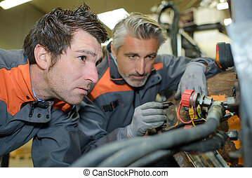 two workers solving a problem
