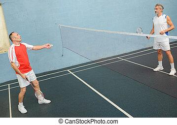 men playing badminton