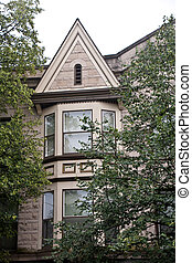 Brown Gabled Bay Windows - A two story bay window on a brown...