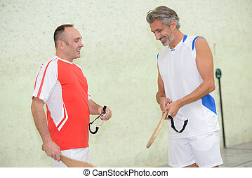 Sportsmen with wooden rackets
