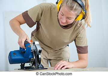 woman builder with earmuffs