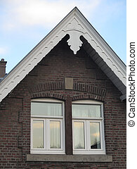 Traditional ornate wood Soffit on building in Dutch town