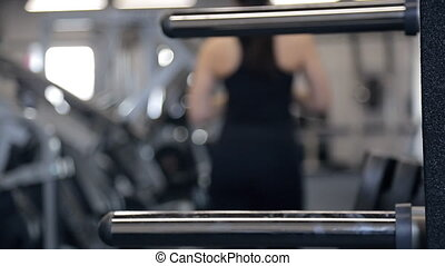 Unfocused shooting woman going out in fitness studio -...