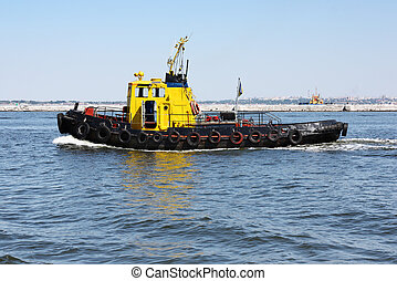 Tugboat underway at speed