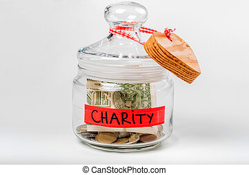Jar with money with a charity label