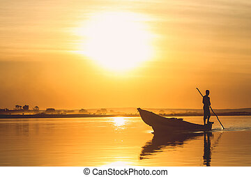 Pirogue at sunset - Traditional fishing pirogue at sunset on...
