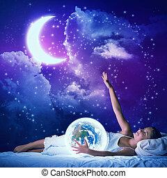 Girl dreaming before sleep - Cute girl in bed looking at...