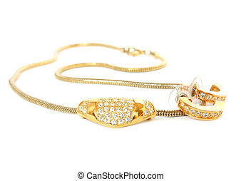golden necklace and ear-rings isolated