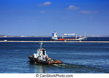 tugboat underway at speed in port