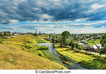 Summer rural landscape with river and clouds