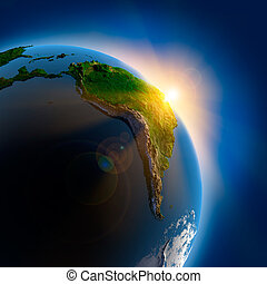 Sunrise over the Earth in outer space - The sun's rays from...