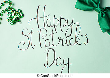Happy St Patrick day calligraphy card and green accessories