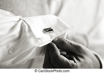 Cufflinks - Groom affixing cufflinks
