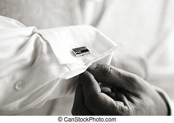 Cufflinks - Groom affixing cufflinks