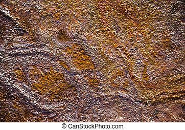 Rainbow oil slick on the sand. Textured background....
