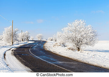 Beautiful winter roadtrip - Picture of a country road on...