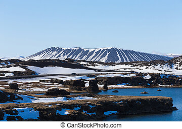 Myvatn volcano over blue lake with clear blue sky...