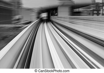 Motion blurred sky train moving to tunnel