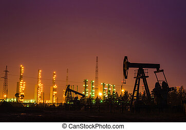Oil rig at the background of refinery.