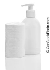 Wadded disks and white plastical bottle isolated