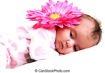 sweet newborn baby girl peaceful with a big pink flower on...