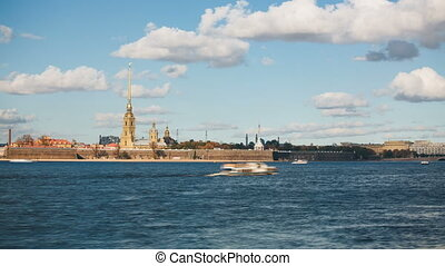Peter and Paul Fortress across the Neva river with boats...
